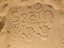 Handprints in sand. Three hand prints in the sand in Spain with the word Spain written in the sand Royalty Free Stock Photography