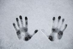 Handprints on the snow, background image. The Handprints on the snow, background image stock images