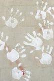 Handprints sur la colle photos stock