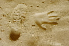 Handprints and trekking shoe print in a sand cave, Bulgaria Royalty Free Stock Photos
