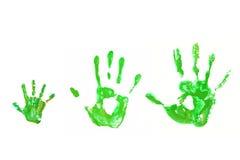Handprints verdes bebé, padre, madre, concepto de la ecología. Imagen de archivo libre de regalías