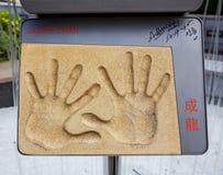 Handprints y firma de Jackie Chan Imagen de archivo libre de regalías