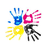 Handprints yellow, blue, pink and black Stock Image