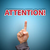 Handpunt aan AANDACHT aan alarm Royalty-vrije Stock Afbeeldingen