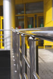 Handrail. In a Shopping mall or railstation. Focus on Handrail in foreground Stock Photos