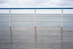 Handrail. On a deck in the rainy day stock photography