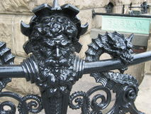 Handrail. Metal image of neptune on a handrail in New York City Stock Images