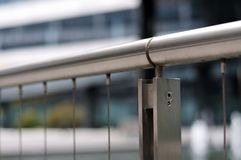 Handrail of a bannister of stainless steel. Close-up of handrail of a bannister constructed with stainless steel and wire rope stock photos
