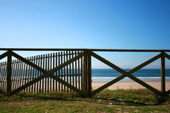 Handrail beach. Wood handrail of a Mediterranean beach Stock Photos