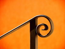 Handrail (8). Black handrail and housewall in the sunlight Royalty Free Stock Images