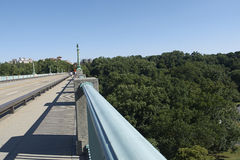 Handrail on bridge. Handrail of a bridge overlooking trees and greenery in Washington DC Stock Images
