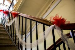 Decorated handrail. Handrail decorated with red bows for festive events royalty free stock photos