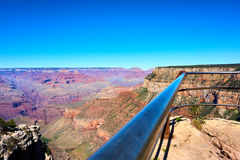 Handrail of a fence in front of the grand canyon landscape. Arizona, USA stock photo