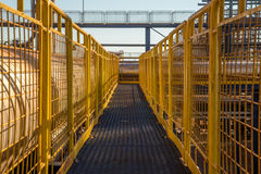 Handrail industrial yellow fence. Metallic factory platform royalty free stock images
