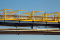 Handrail industrial yellow fence. Metallic steel structure stock image