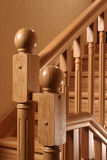 Handrail of a ladder. A wooden handrail of a ladder royalty free stock photo