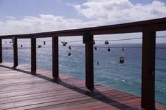 Handrail with love locks Stock Photos