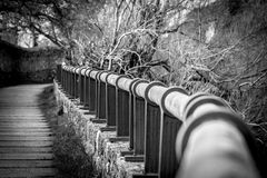 Handrail in perspective. On a winding road stock photo