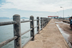 Handrail on the pier on the background of the sea. Thailand asia. Concrete road stock photography