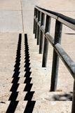 Handrail shadow on stairs. A picture of a handrail shadow on stairs in Jerome Arizona stock photography
