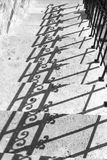 Handrail shadow black and white version. Handrail shadow on the stone staircase stock photo
