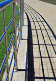 Handrail and shadows Royalty Free Stock Images