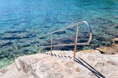 Handrail swimming on the beach of the sea. Steel handrail, swimming, blue sea, seaside, waves, summer, travel, natural environment, Mediterranean, Adriatic sea stock photos
