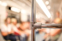 Handrail on the train in the metro.  stock photography