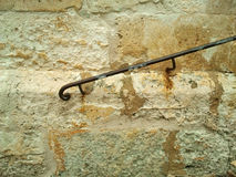 Handrail on wall. Close up of a metal handrail fixed to an old stone wall, shot on mobile phone camera stock photos