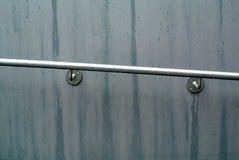 Handrail. The wet gray metal handrail royalty free stock photos
