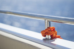 Handrail of the white yacht. Brilliant handrail on the deck of the white yacht Stock Photography