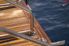 Handrail on the yacht. The deck of the yacht against the background of the blue sea Royalty Free Stock Photography