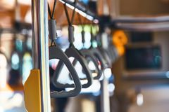 Handrails on the bus. Loops in the bus stock photo
