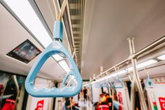Handrails in a metro subway car , Handle or hand straps in MRT for the safety of passenger,Focus on a handrail. A Handrails in a metro subway car , Handle or royalty free stock photo