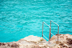 Handrails near the sea. Handrails mounted on rock near the sea royalty free stock photography