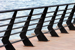 Handrails on a pier. Against sea background Stock Image