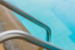 Handrails of the pool. Handrails on the stairs of the pool royalty free stock photography