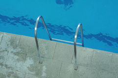 Handrails for stairs out of the water Royalty Free Stock Photography