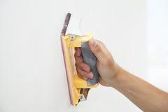 Handreibende Wand mit Sandpapier Lizenzfreie Stockbilder