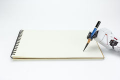 Handrobotergriff ein Bleistiftschreiben auf Hintergrund Stockfotografie