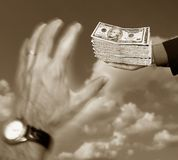 Hands and 10 dollars Stock Images