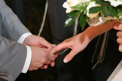 Hands. Married couple holding hands Stock Images