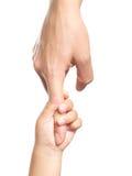 Hands. Little hands hold big finger Royalty Free Stock Images