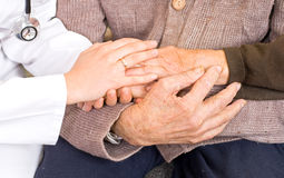 Hands. Young doctor holding the lady's hand Stock Image