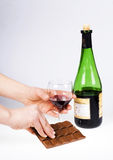 Hands. Are holdings glass and bottle of wine Stock Photo
