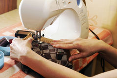 Hands. Of woman working on a sewing typewriter Royalty Free Stock Image