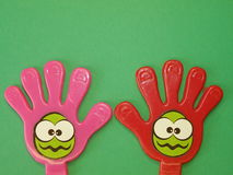 Hands. Plastic hands with smile signs isolated on green Stock Photography
