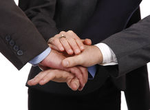 Hands on. Teamwork represented as hands together in a deal Stock Images