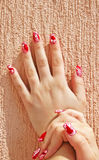 Hands. Hand with nail art isolated on wall background Royalty Free Stock Images