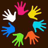 Hands. Colorful kids hands on dark background Stock Photo